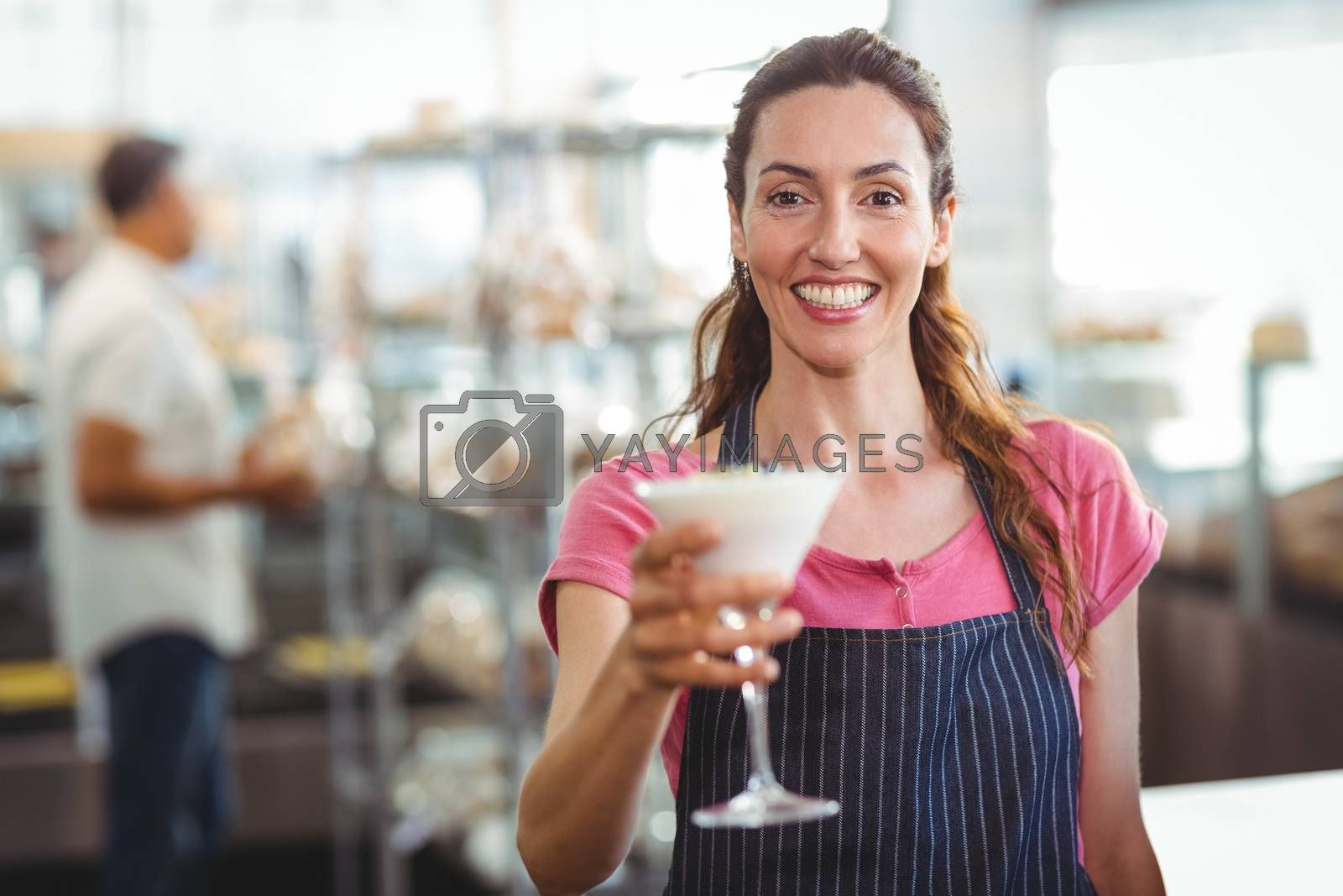 Royalty free image of worker offering a parfait by Wavebreakmedia