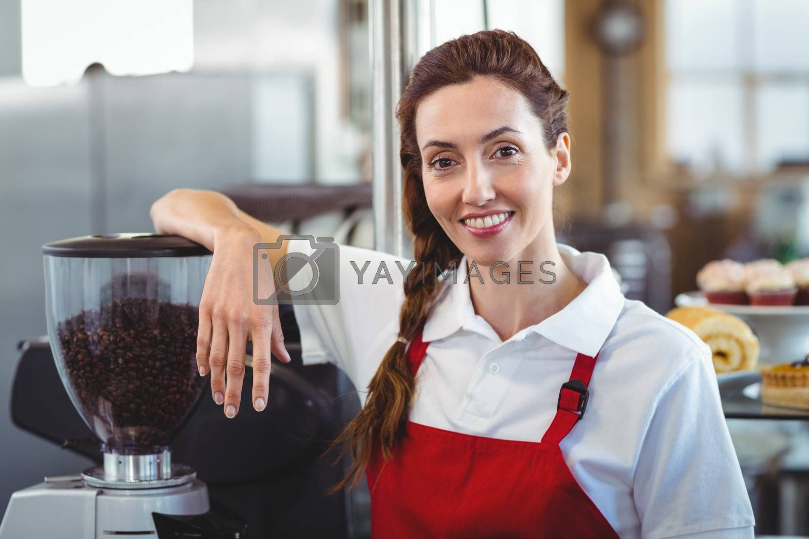 Royalty free image of Pretty barista smiling at camera  by Wavebreakmedia