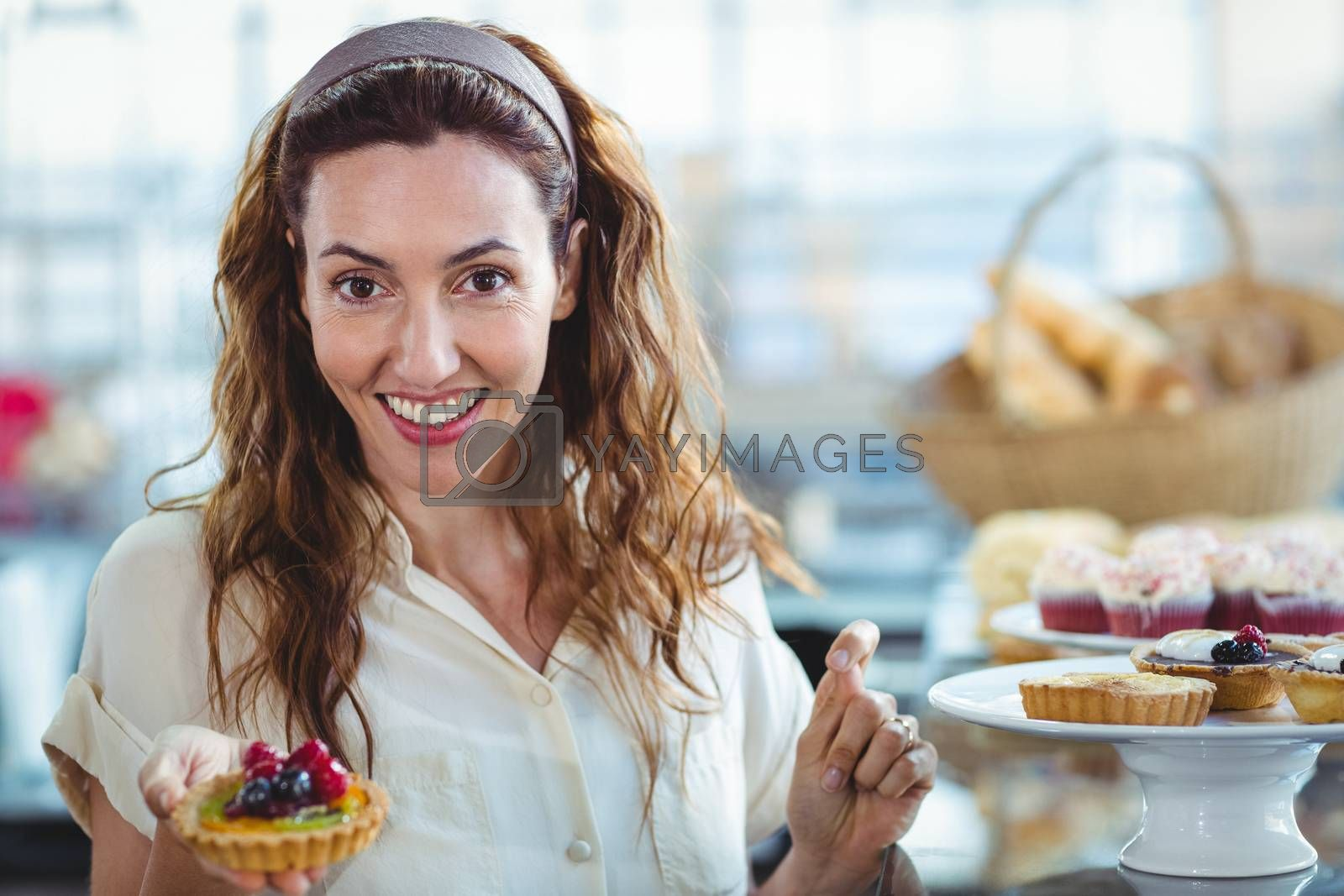 Royalty free image of Astonished pretty woman looking at camera by Wavebreakmedia