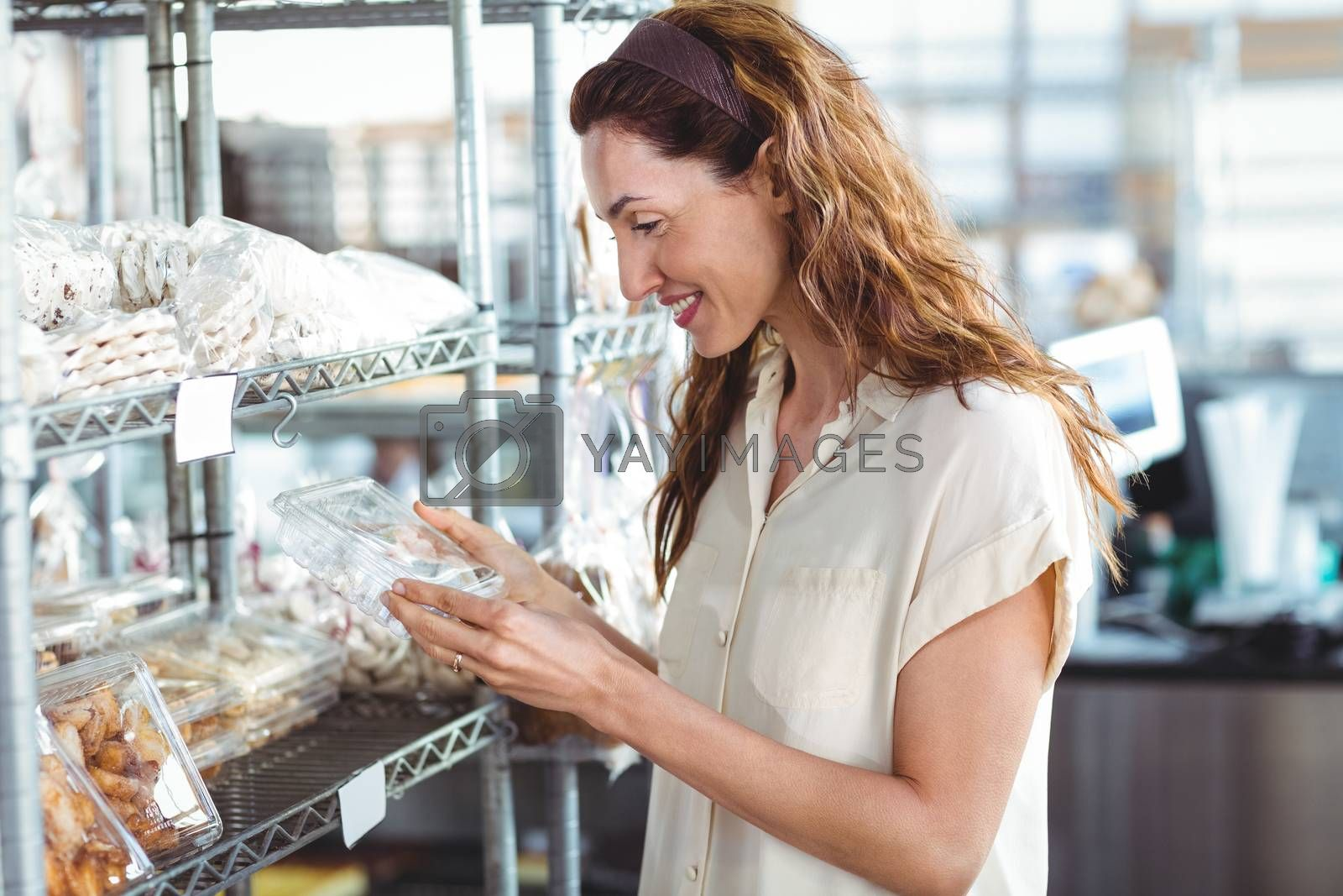Royalty free image of Pretty woman shopping in the bakery by Wavebreakmedia