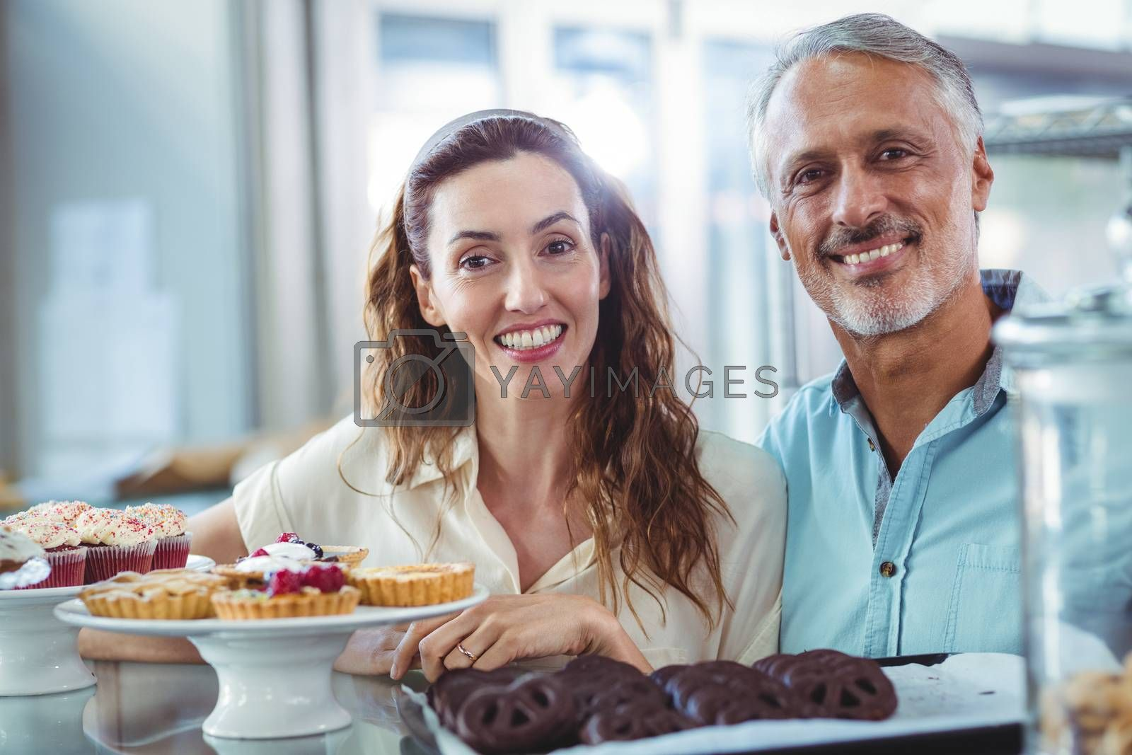 Royalty free image of Cute couple looking at camera by Wavebreakmedia