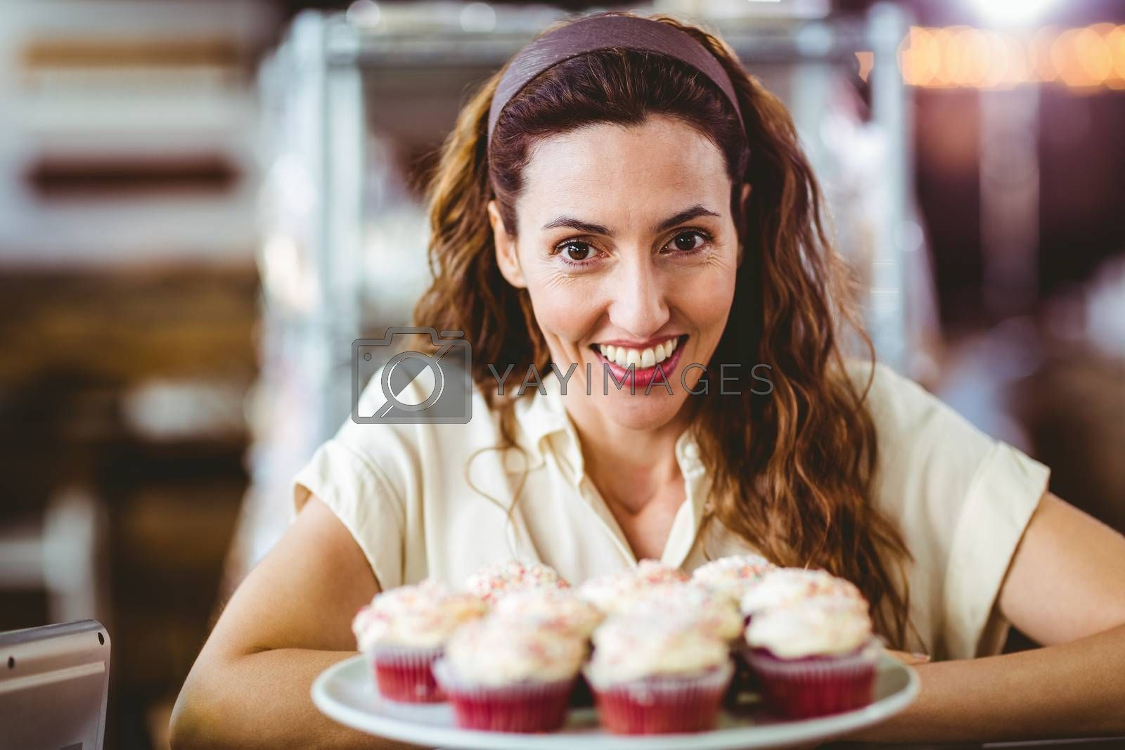 Royalty free image of Pretty brunette smiling at camera by Wavebreakmedia