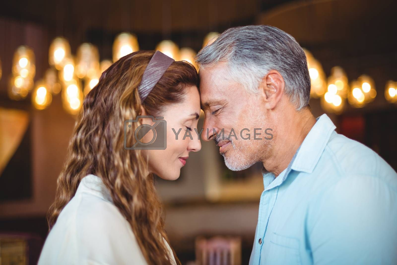 Royalty free image of Happy couple with theirs heads close together by Wavebreakmedia
