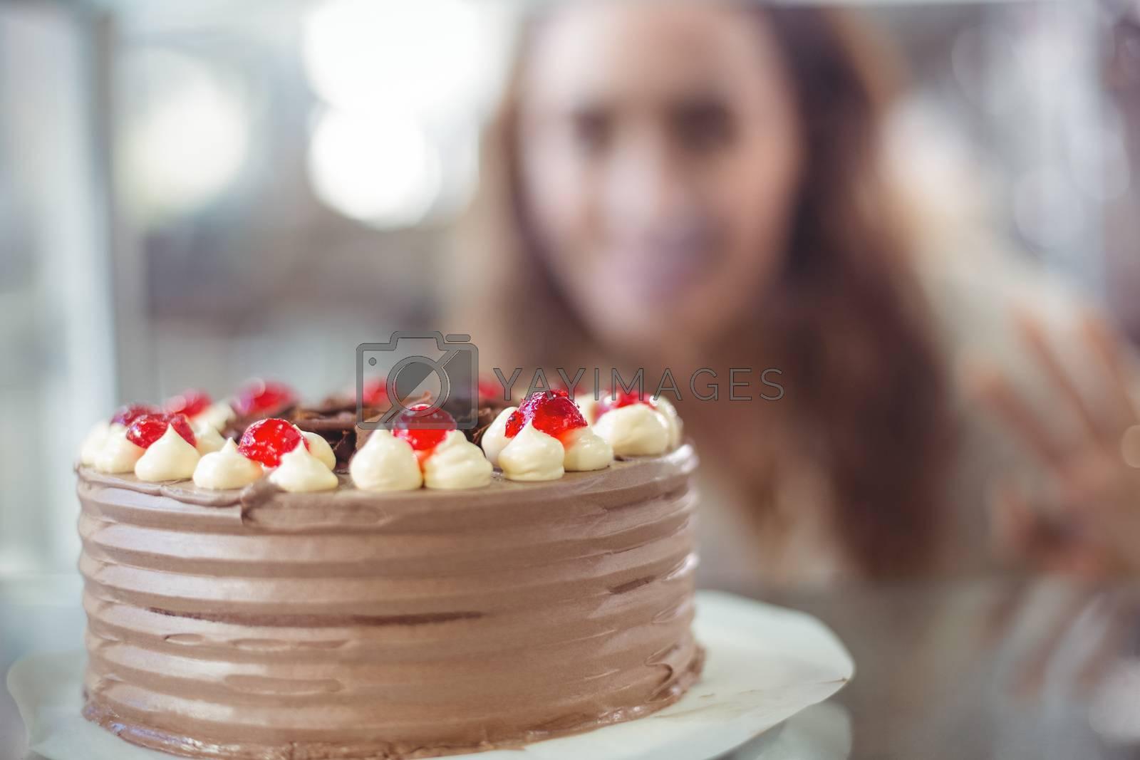 Royalty free image of Display case of chocolate cake by Wavebreakmedia