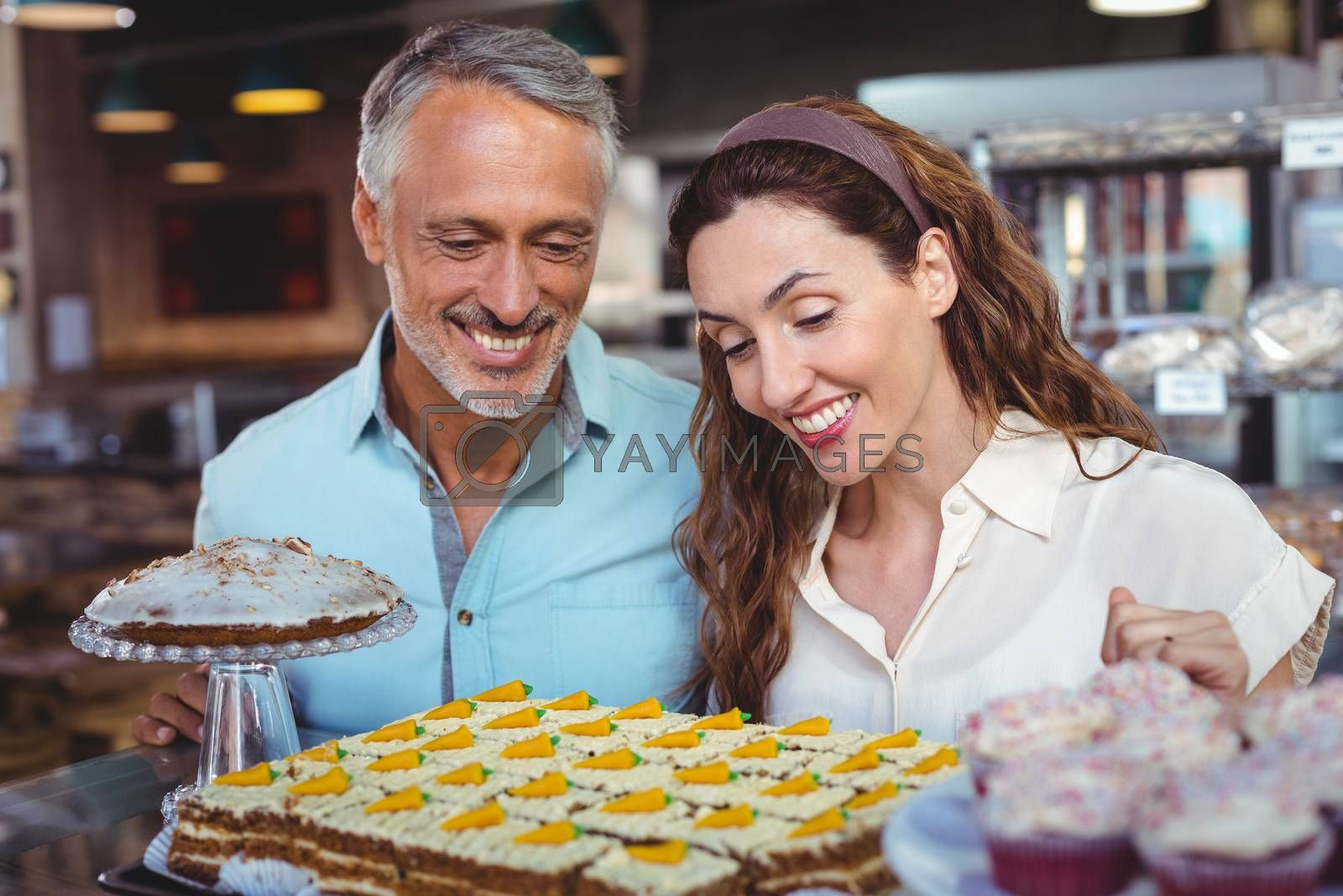 Royalty free image of Cute couple looking at pastries by Wavebreakmedia
