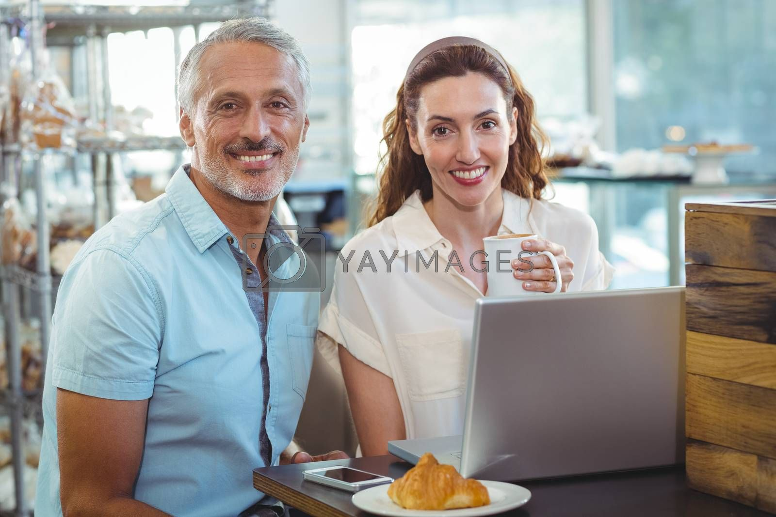 Royalty free image of Happy couple smiling at camera by Wavebreakmedia