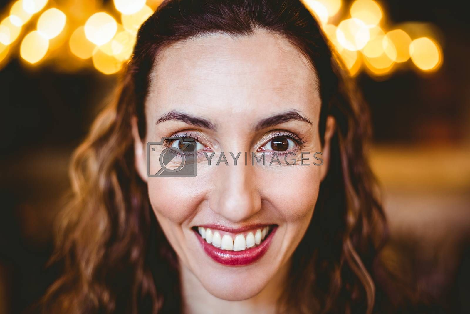 Royalty free image of Close up of pretty brunette smiling at camera by Wavebreakmedia