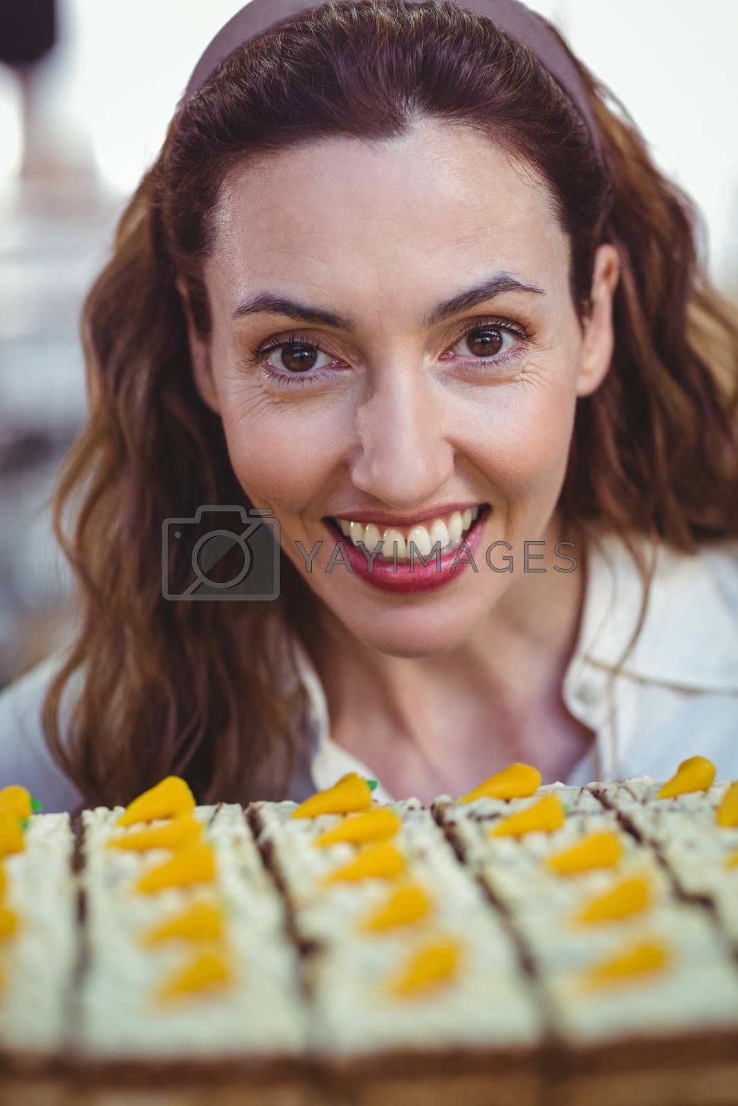 Royalty free image of Pretty brunette looking at pastries by Wavebreakmedia