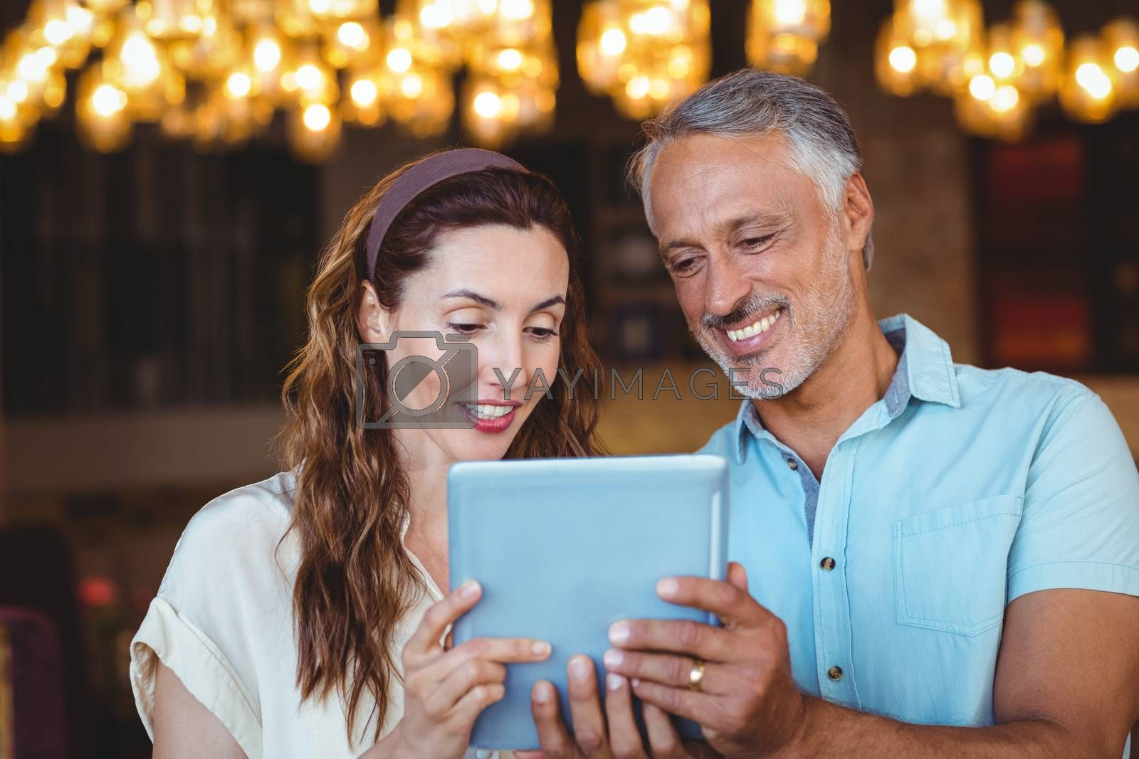 Royalty free image of Happy couple using tablet together  by Wavebreakmedia