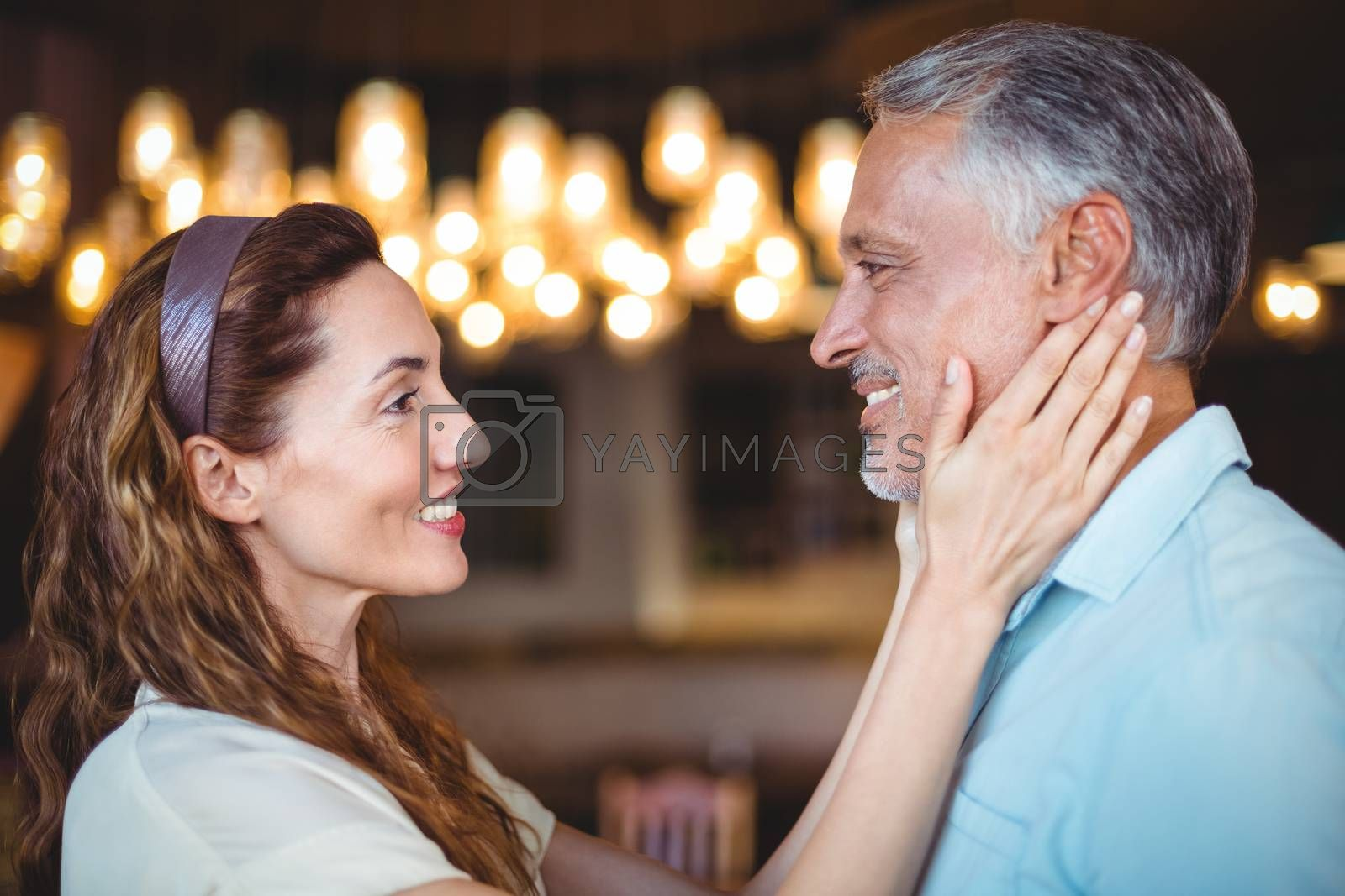 Royalty free image of Happy woman touching her husband by Wavebreakmedia
