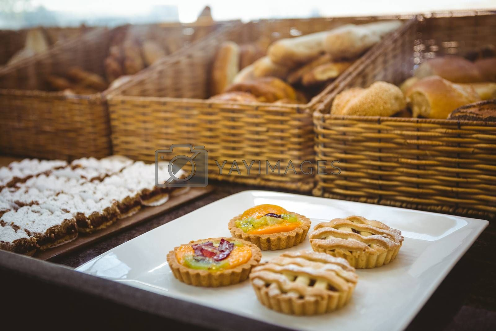 Royalty free image of Close up of basket with fresh bread and pastry  by Wavebreakmedia