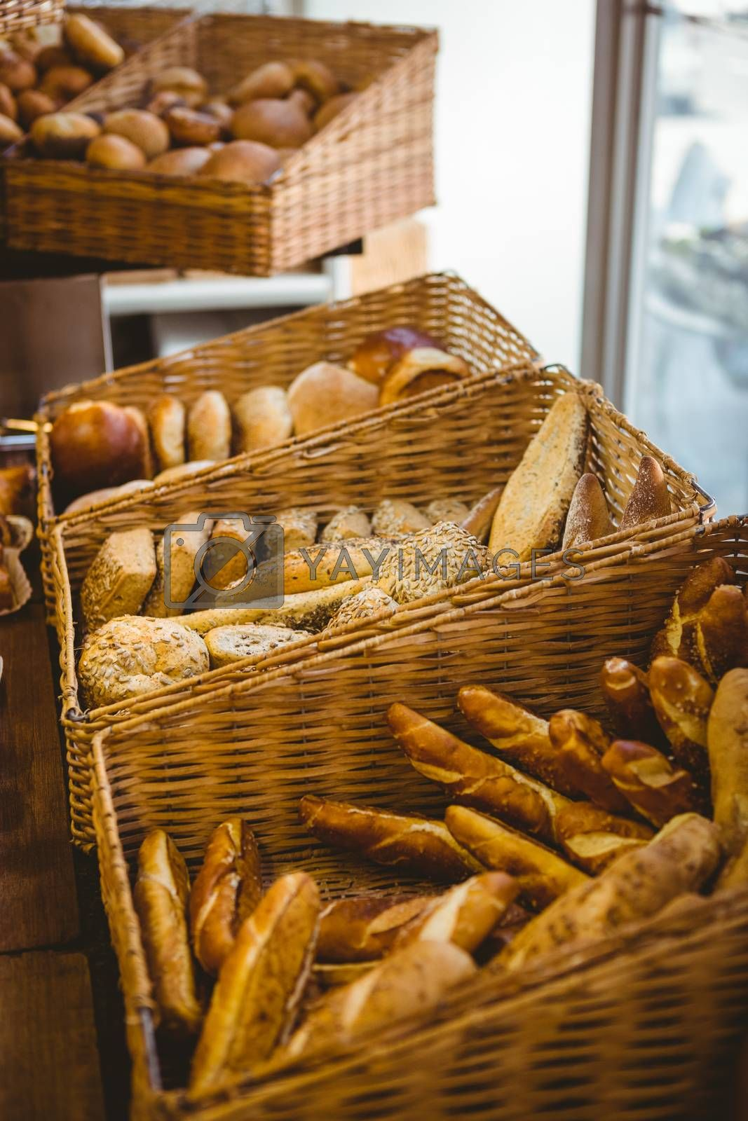 Royalty free image of Close up of basket with fresh bread by Wavebreakmedia
