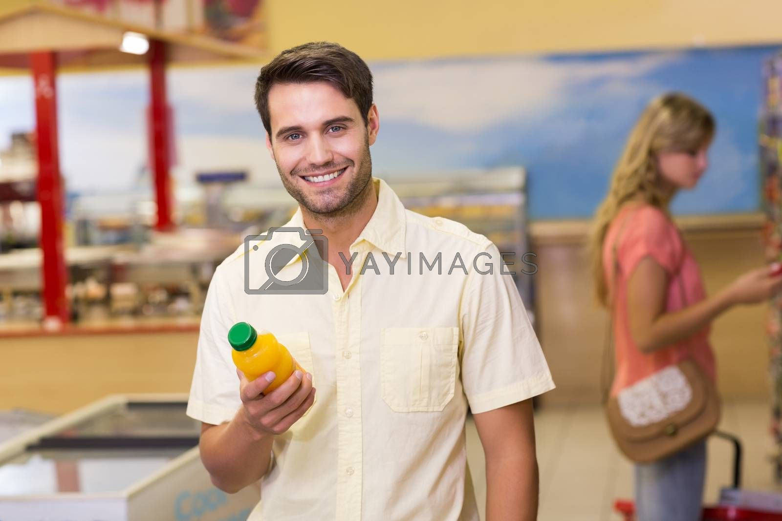 Royalty free image of Portrait of a smiling handome man buying products  by Wavebreakmedia