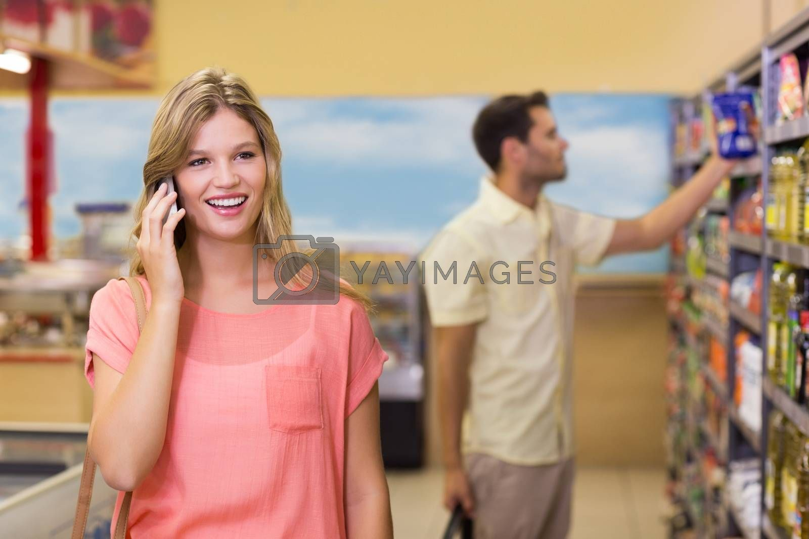 Royalty free image of Smiling pretty blonde woman phoning  by Wavebreakmedia