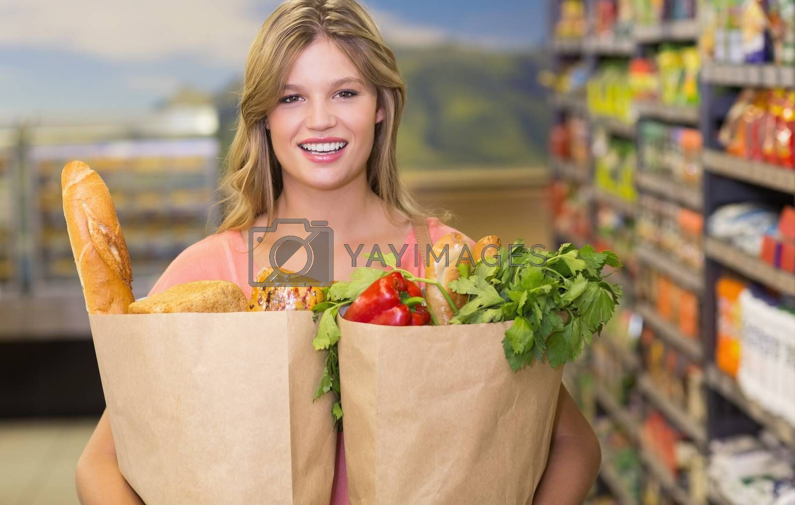 Royalty free image of Portrait of pretty blonde woman buying food products  by Wavebreakmedia