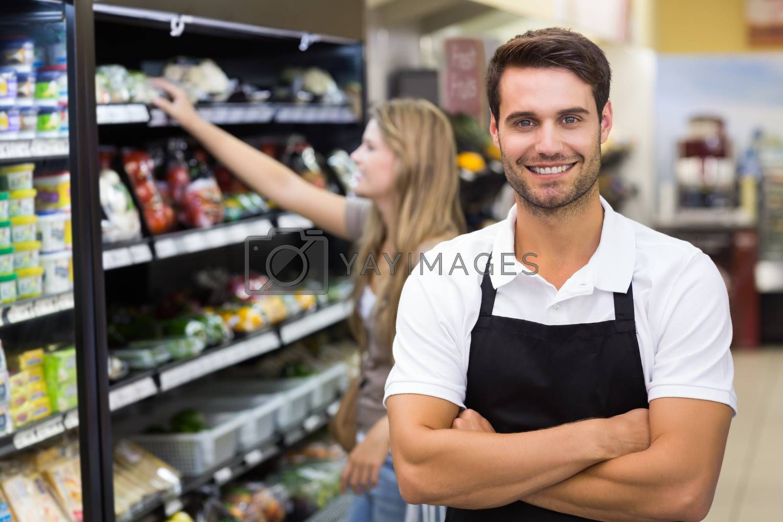 Royalty free image of Portrait of a handsome seller with arm crossed  by Wavebreakmedia