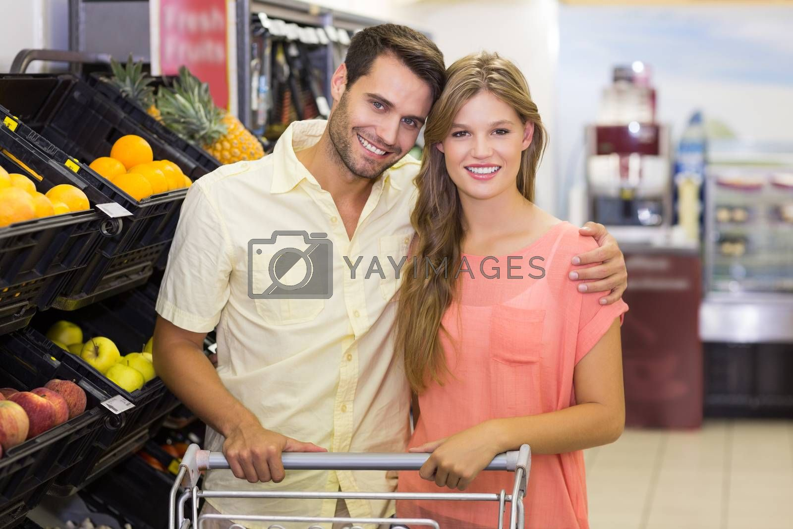 Royalty free image of Portrait of smiling bright couple buying food products by Wavebreakmedia