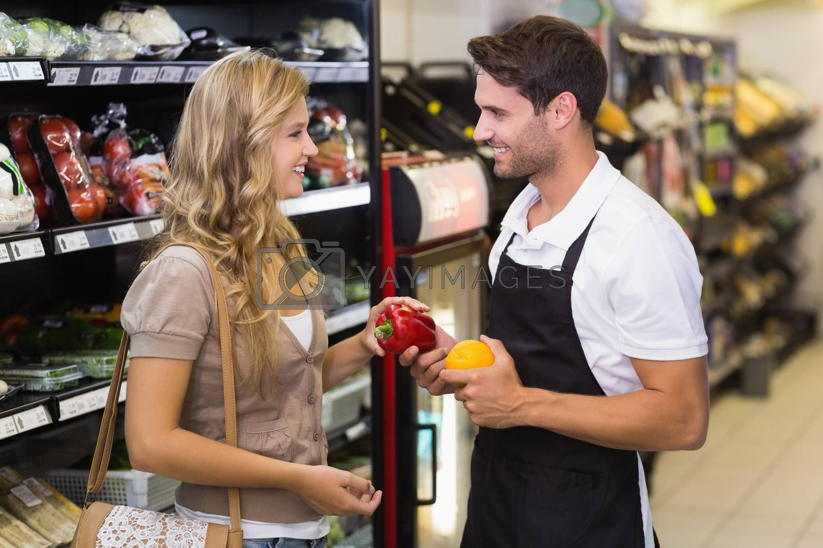 Royalty free image of Smiling blonde woman buying a vegetables  by Wavebreakmedia