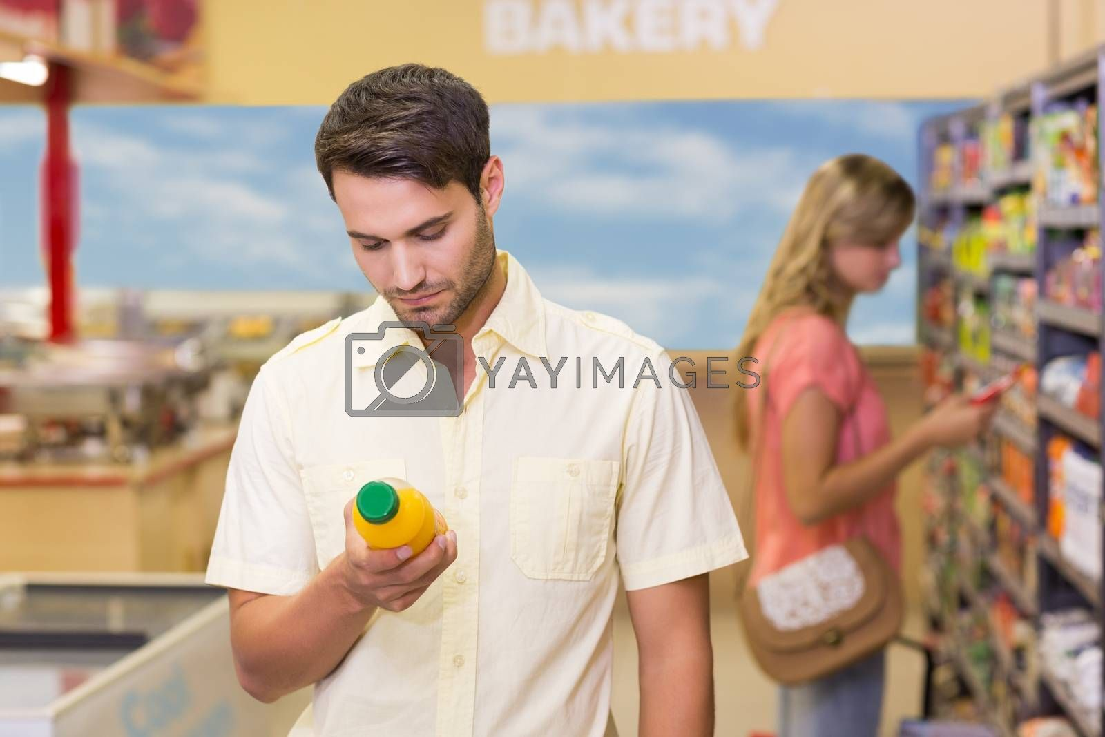 Royalty free image of A handsome man buying products  by Wavebreakmedia