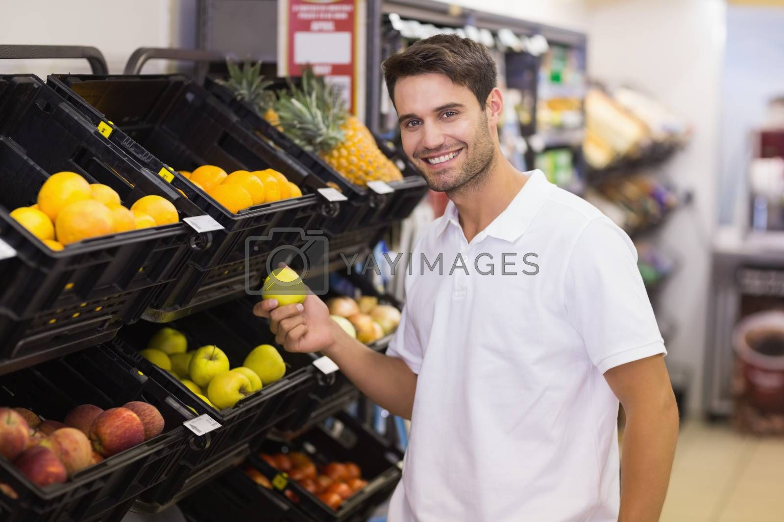Royalty free image of Portrait of a handsome man buying a fruits by Wavebreakmedia