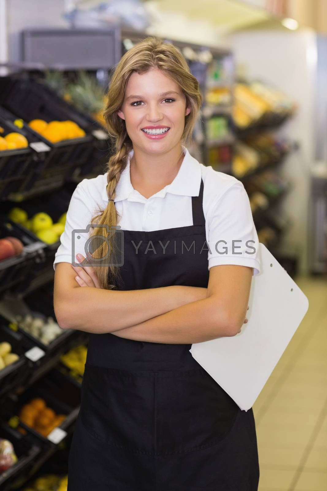Royalty free image of Portrait of a smiling staff woman having a clipboard on her hands  by Wavebreakmedia