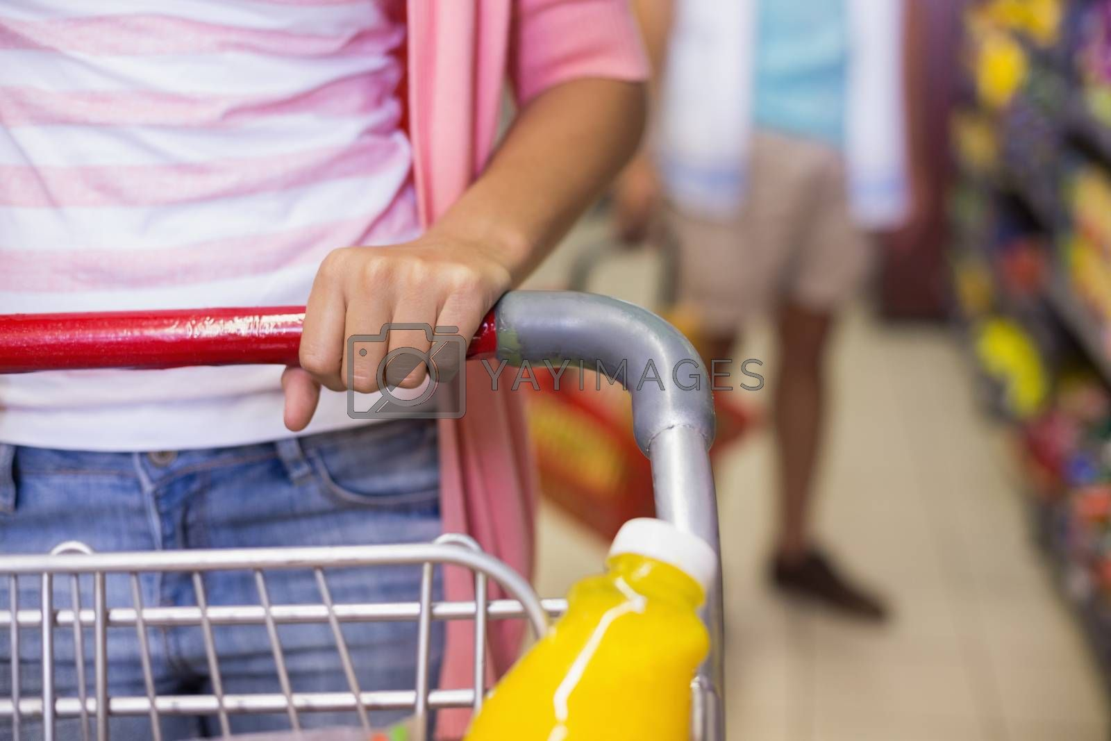 Royalty free image of A young pretty woman buying a products  by Wavebreakmedia