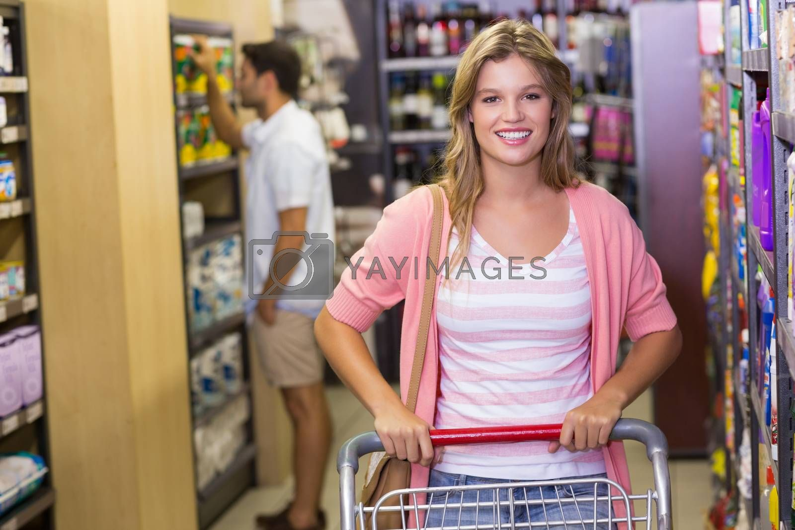 Royalty free image of Portrait of smiling blonde woman buying products by Wavebreakmedia