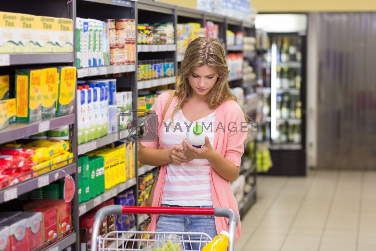 Royalty free image of Pretty blonde woman buying a products  by Wavebreakmedia