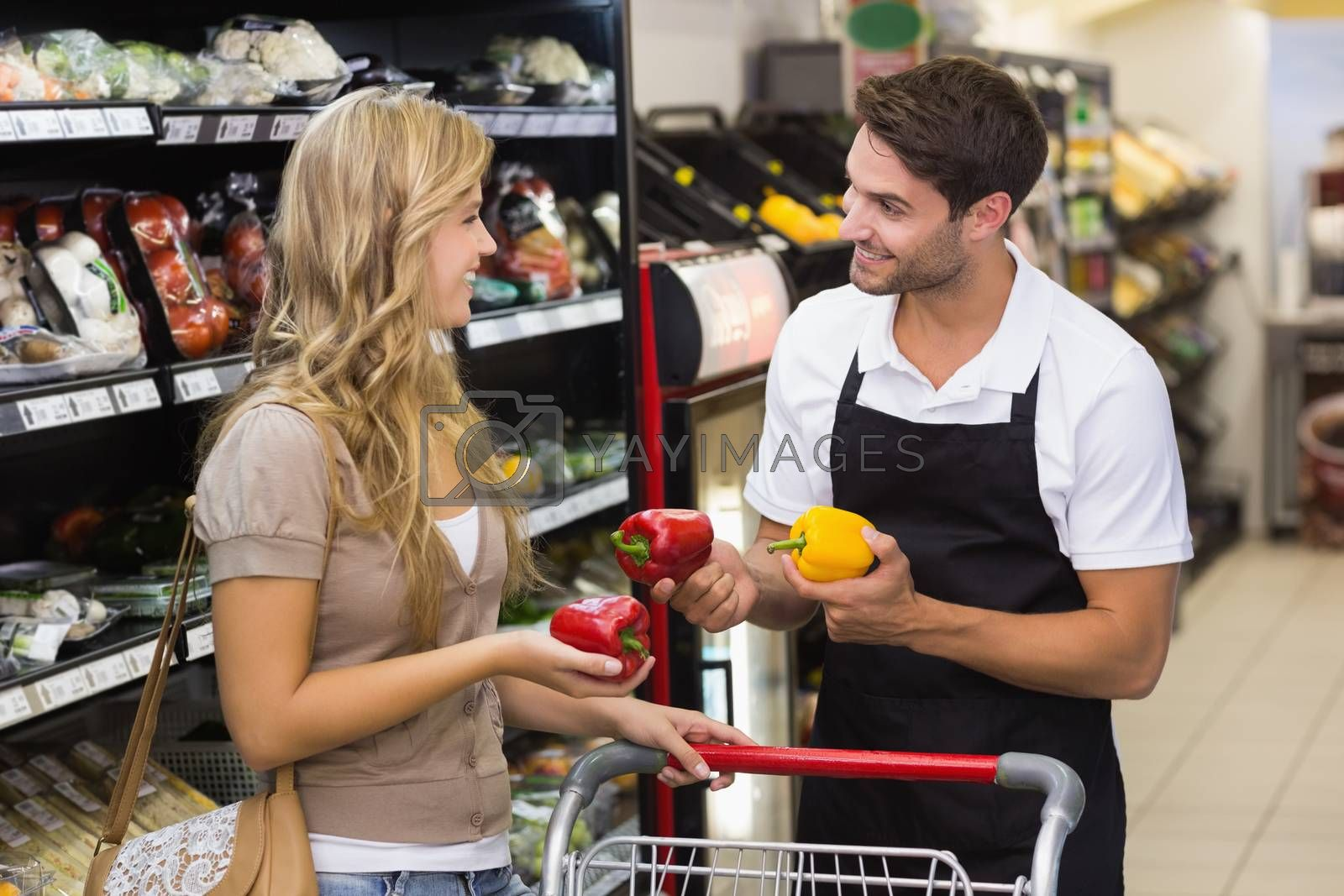 Royalty free image of Smiling pretty blonde woman speaking with seller by Wavebreakmedia