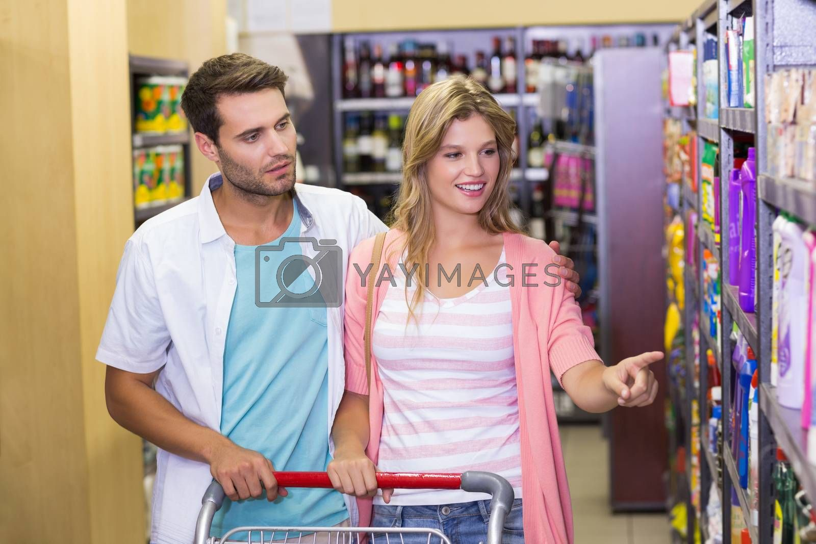 Royalty free image of Smiling bright couple showing a shelf  by Wavebreakmedia