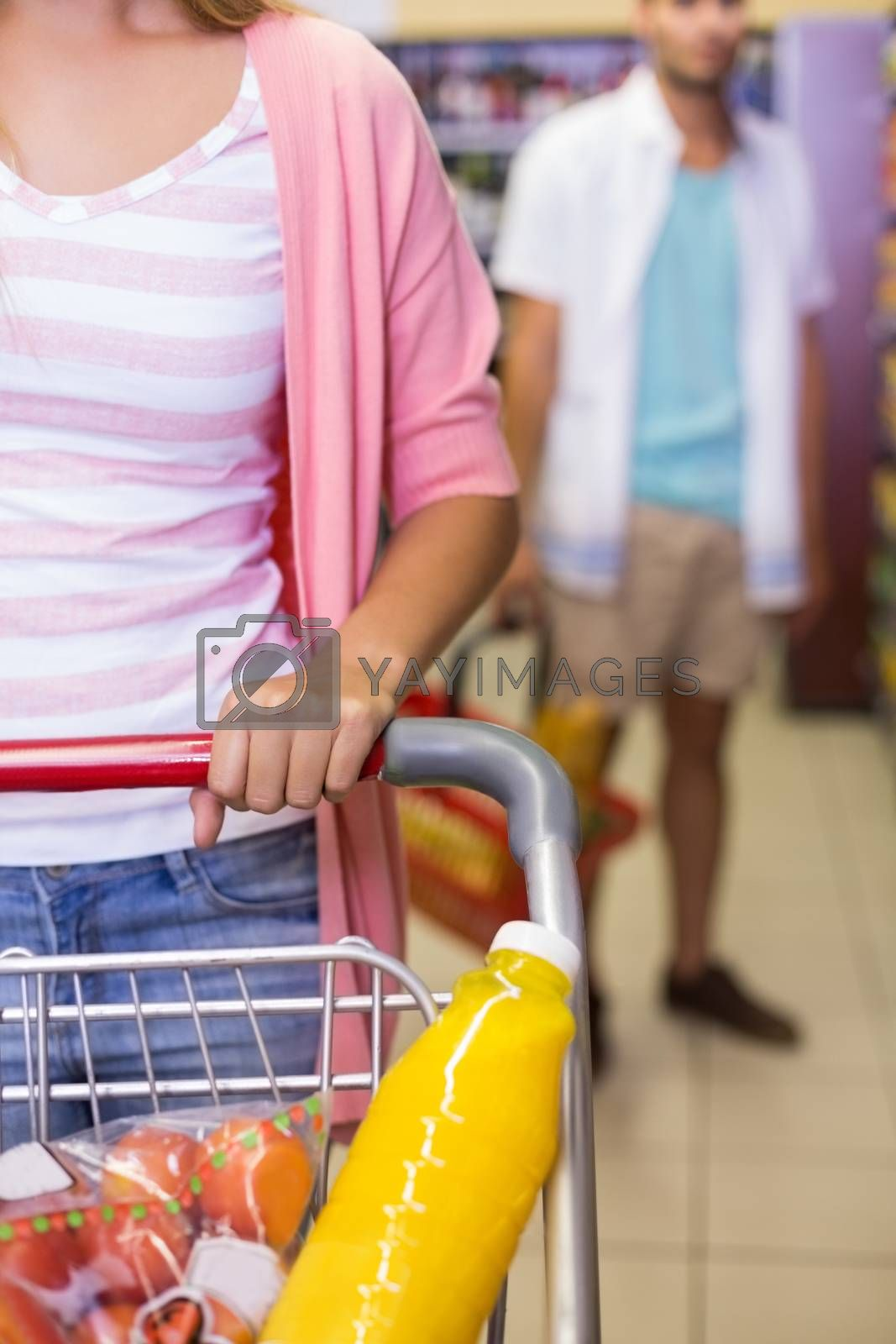 Royalty free image of A young pretty woman buying a food products  by Wavebreakmedia