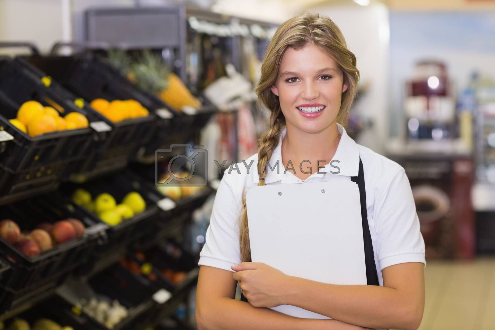 Royalty free image of Portrait of a staff woman having a clipboard on her hands  by Wavebreakmedia
