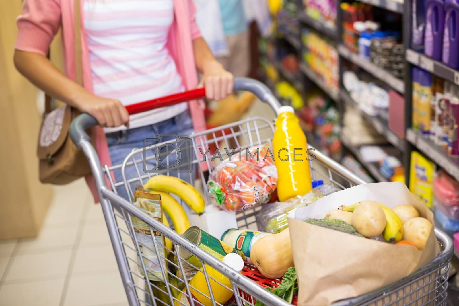 Royalty free image of A young woman buying a products  by Wavebreakmedia