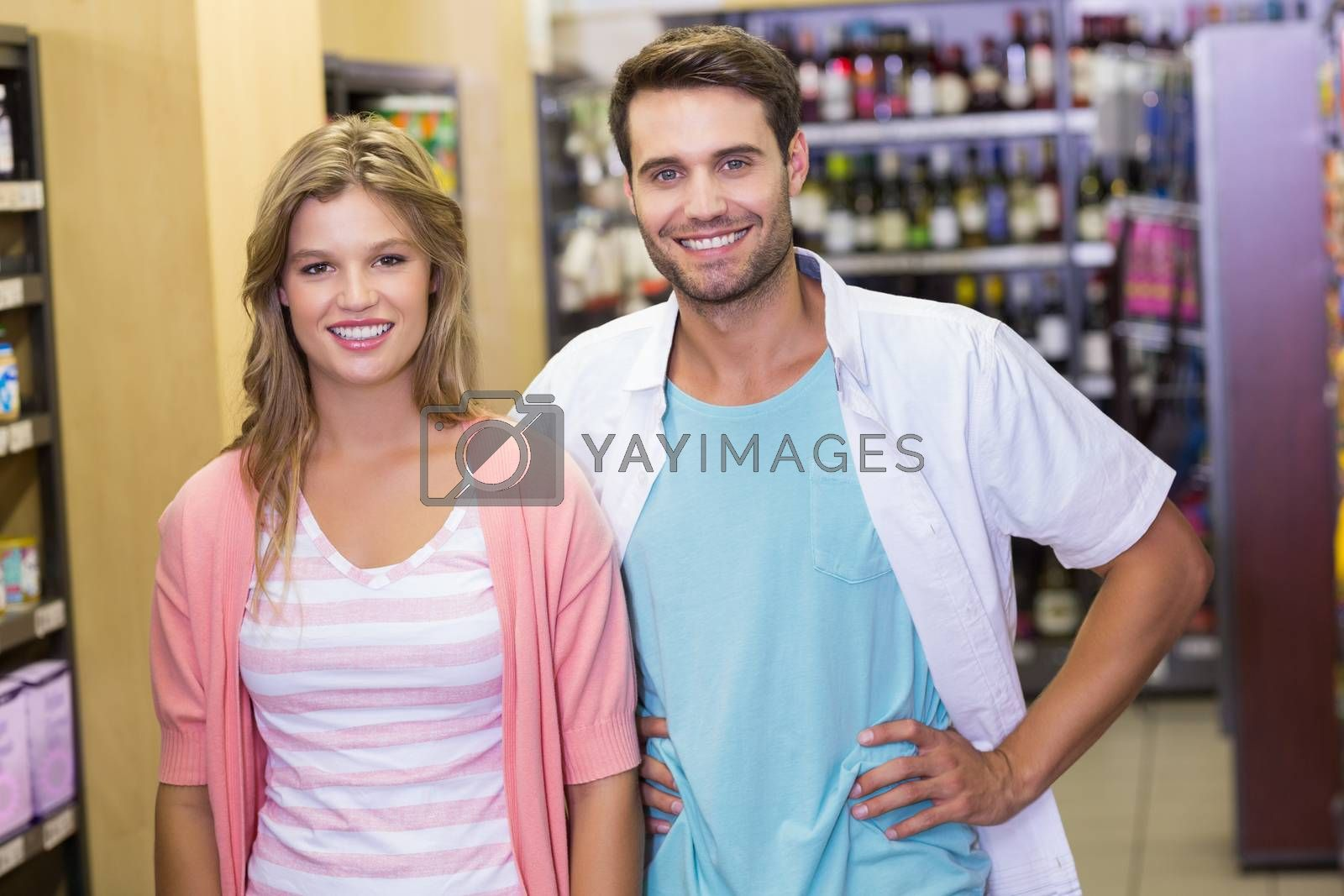 Royalty free image of Portrait of smiling bright couple looking at camera  by Wavebreakmedia