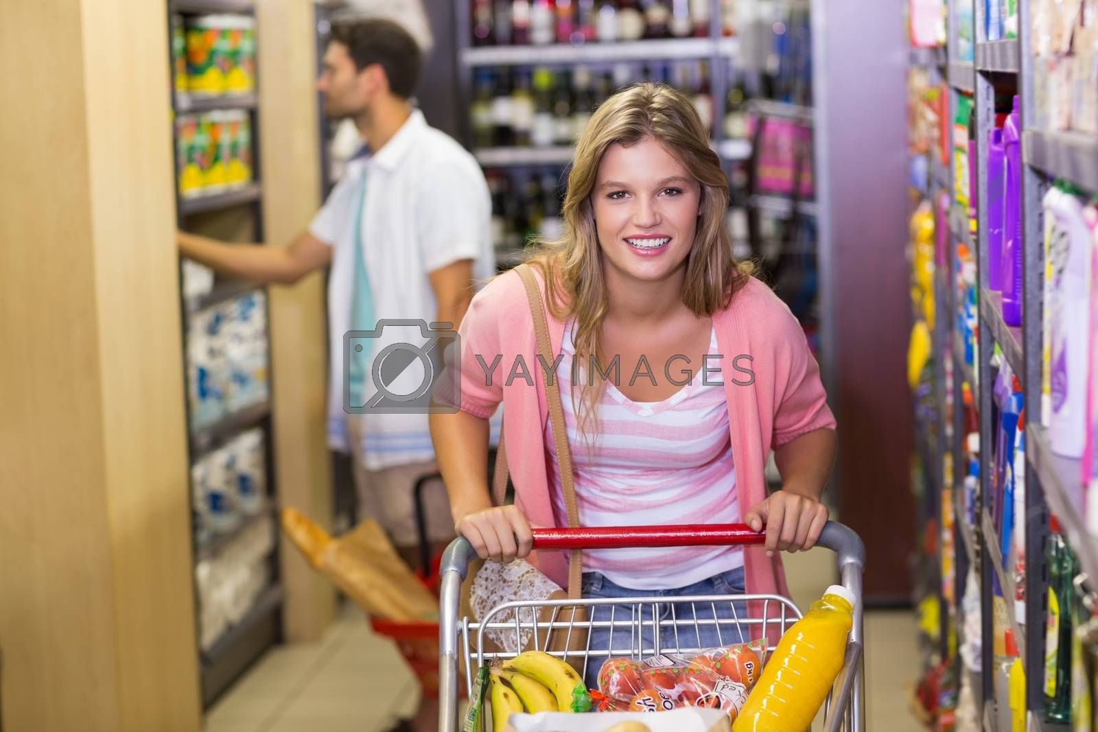 Royalty free image of Portrait of a smiling pretty woman buying products  by Wavebreakmedia
