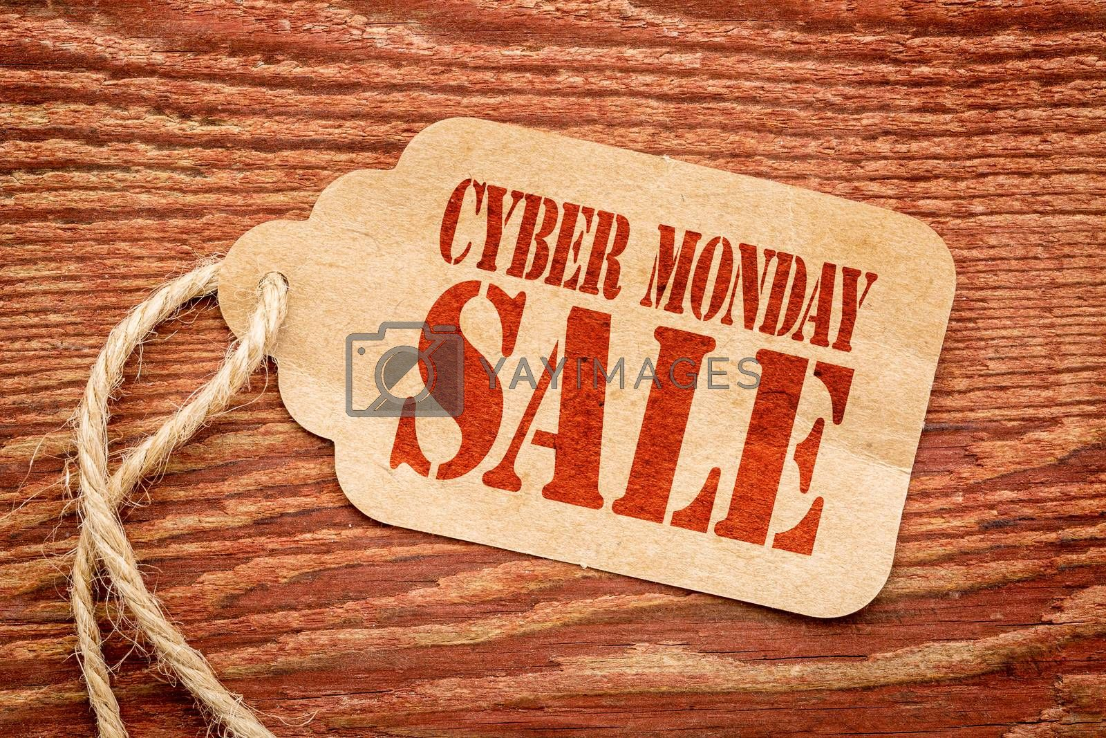 Cyber Monday  sale sign a paper price tag against rustic red painted barn wood