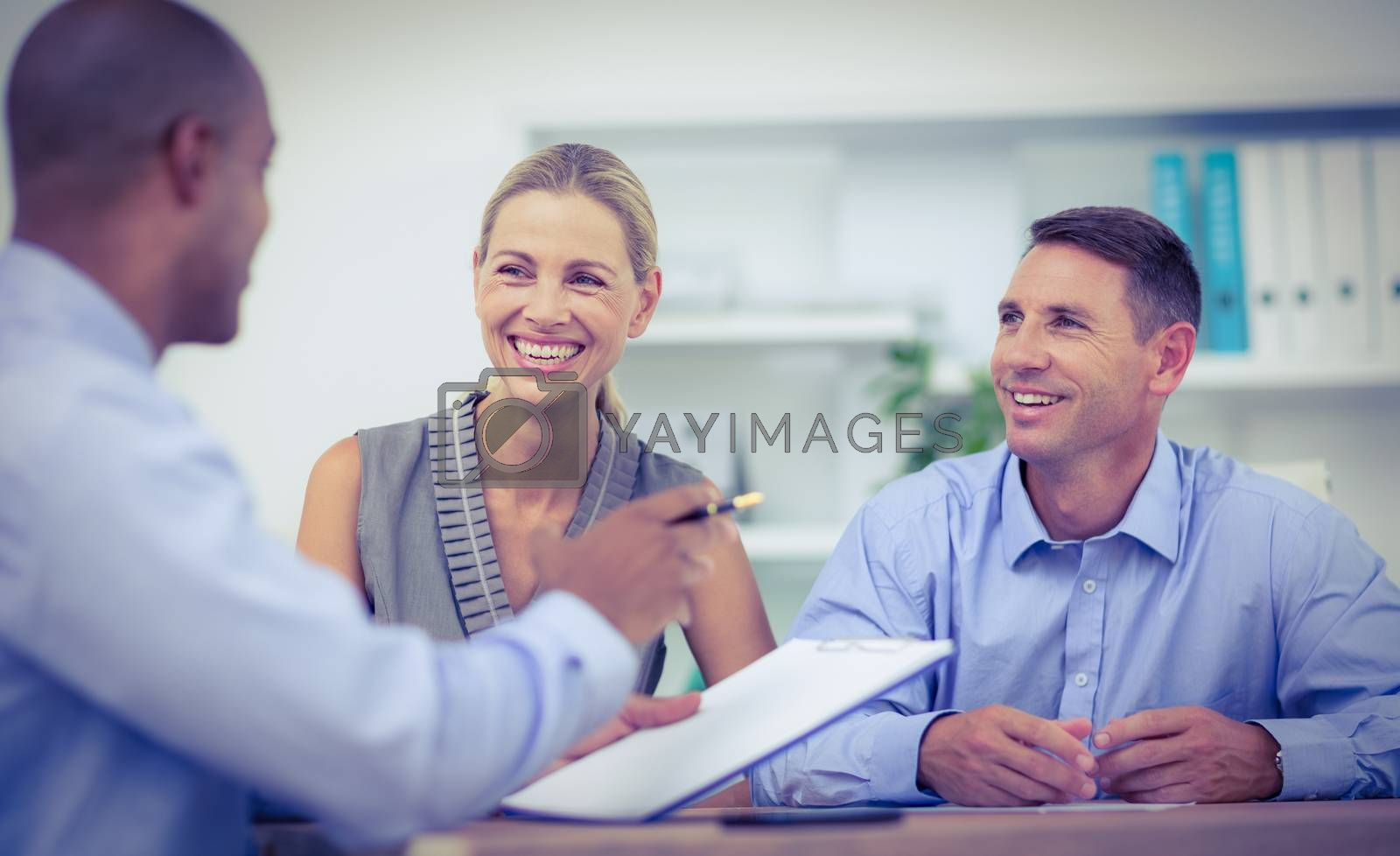 Royalty free image of Business partners working on laptop by Wavebreakmedia