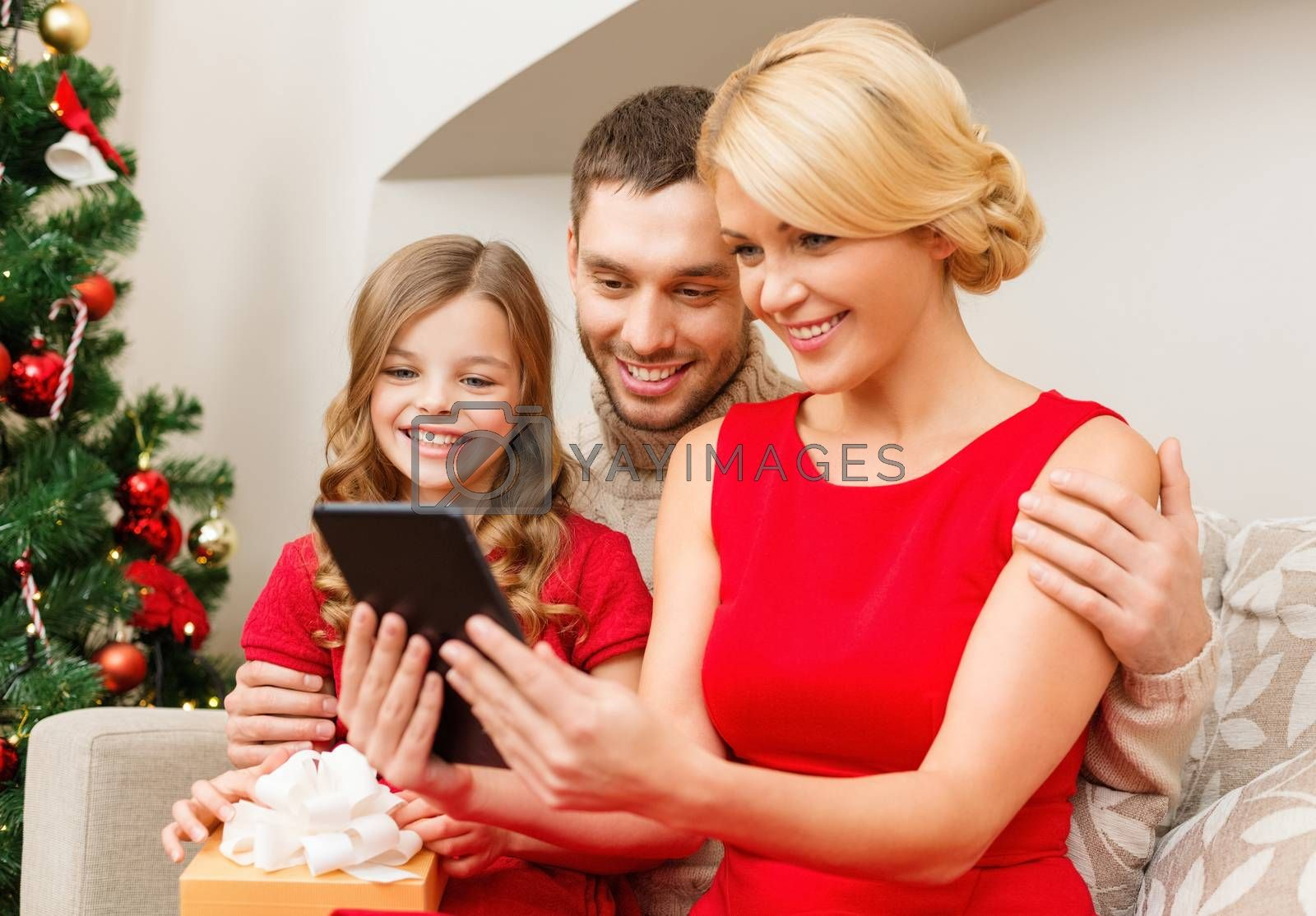 family, christmas, happiness, technology and people concept - smiling family with tablet pc