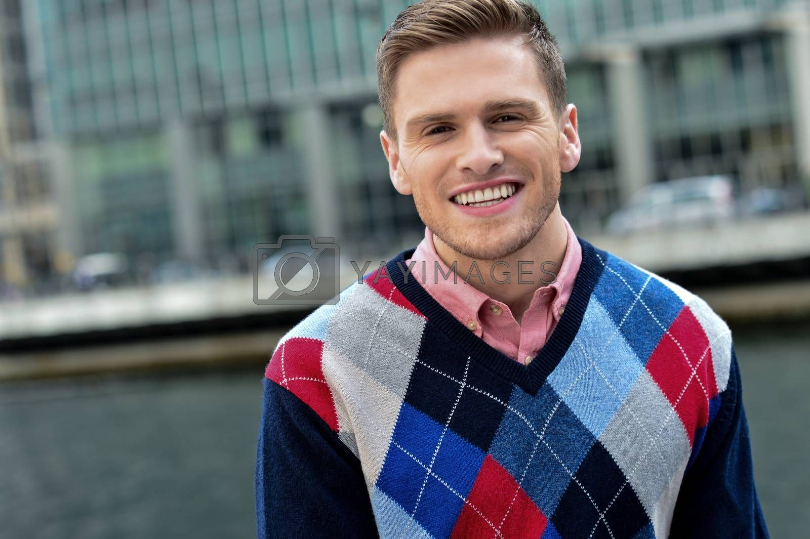 Handsome man looking to camera by stockyimages