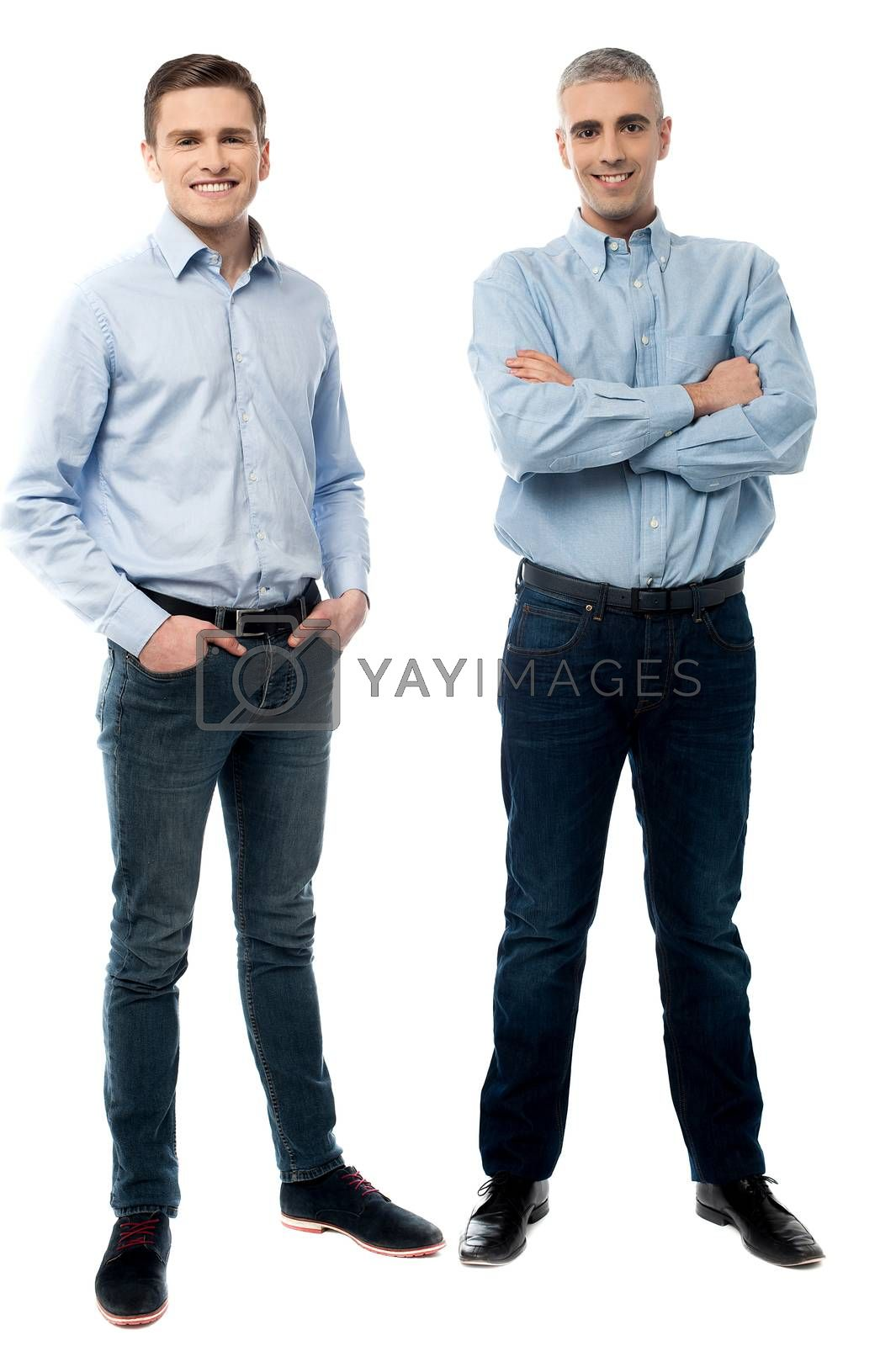 Full length of casual young men posing in style