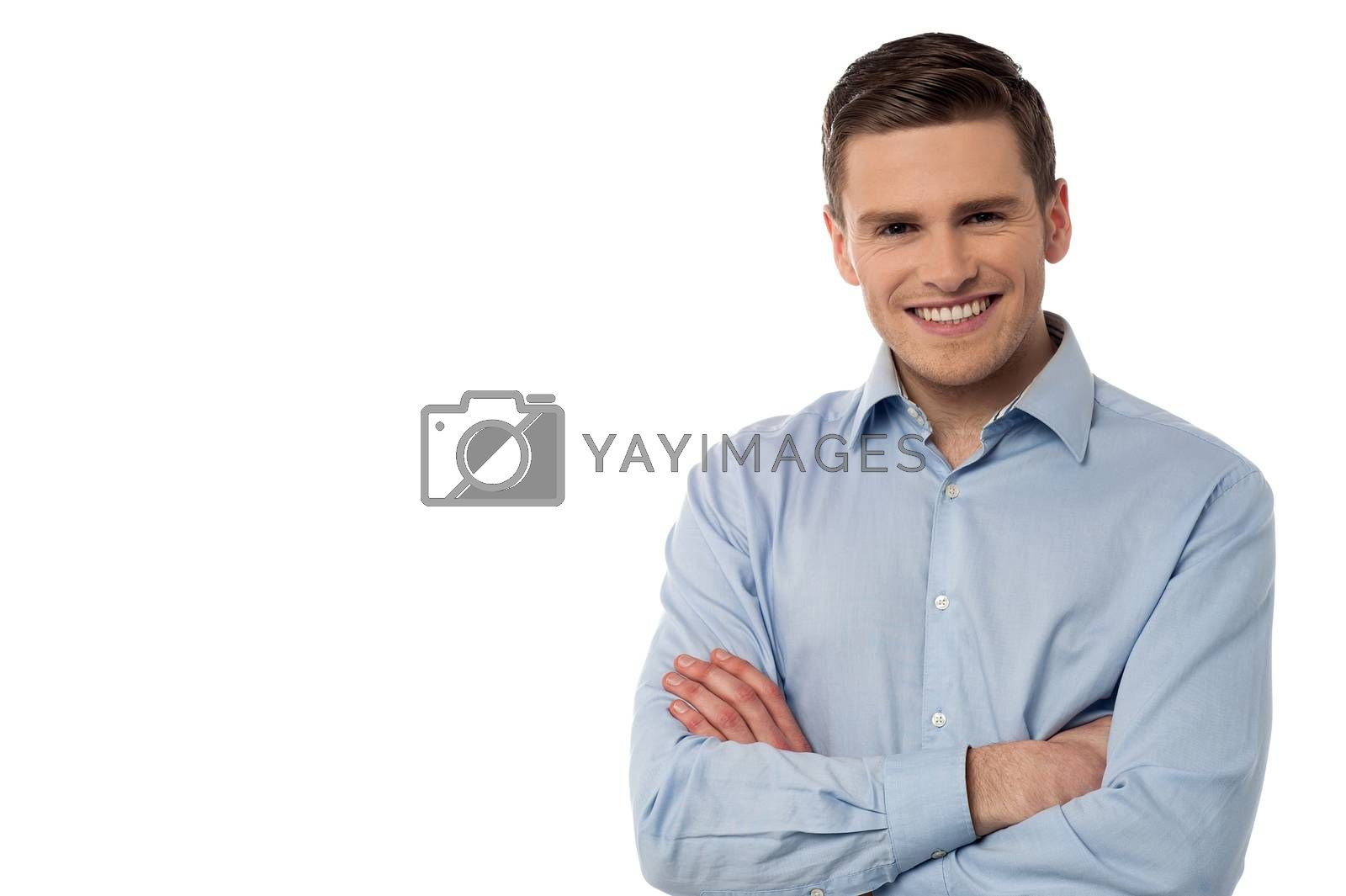 Confident young man looking at camera over white