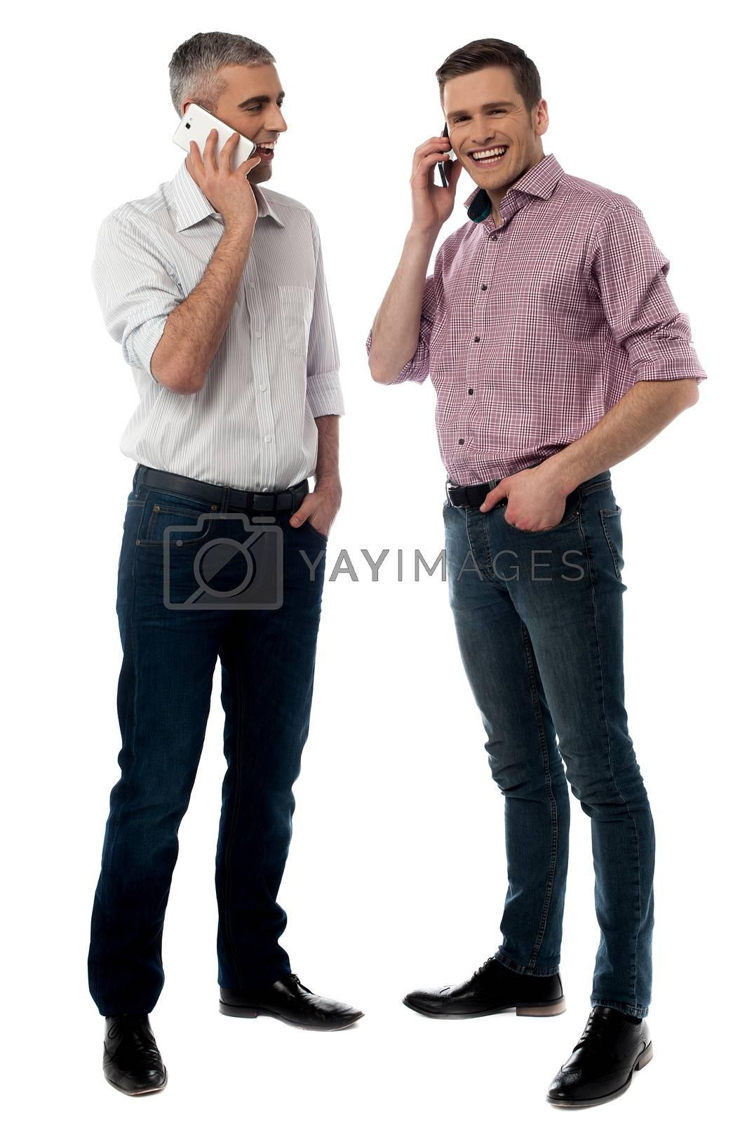 Full length of handsome men talking on cell phone