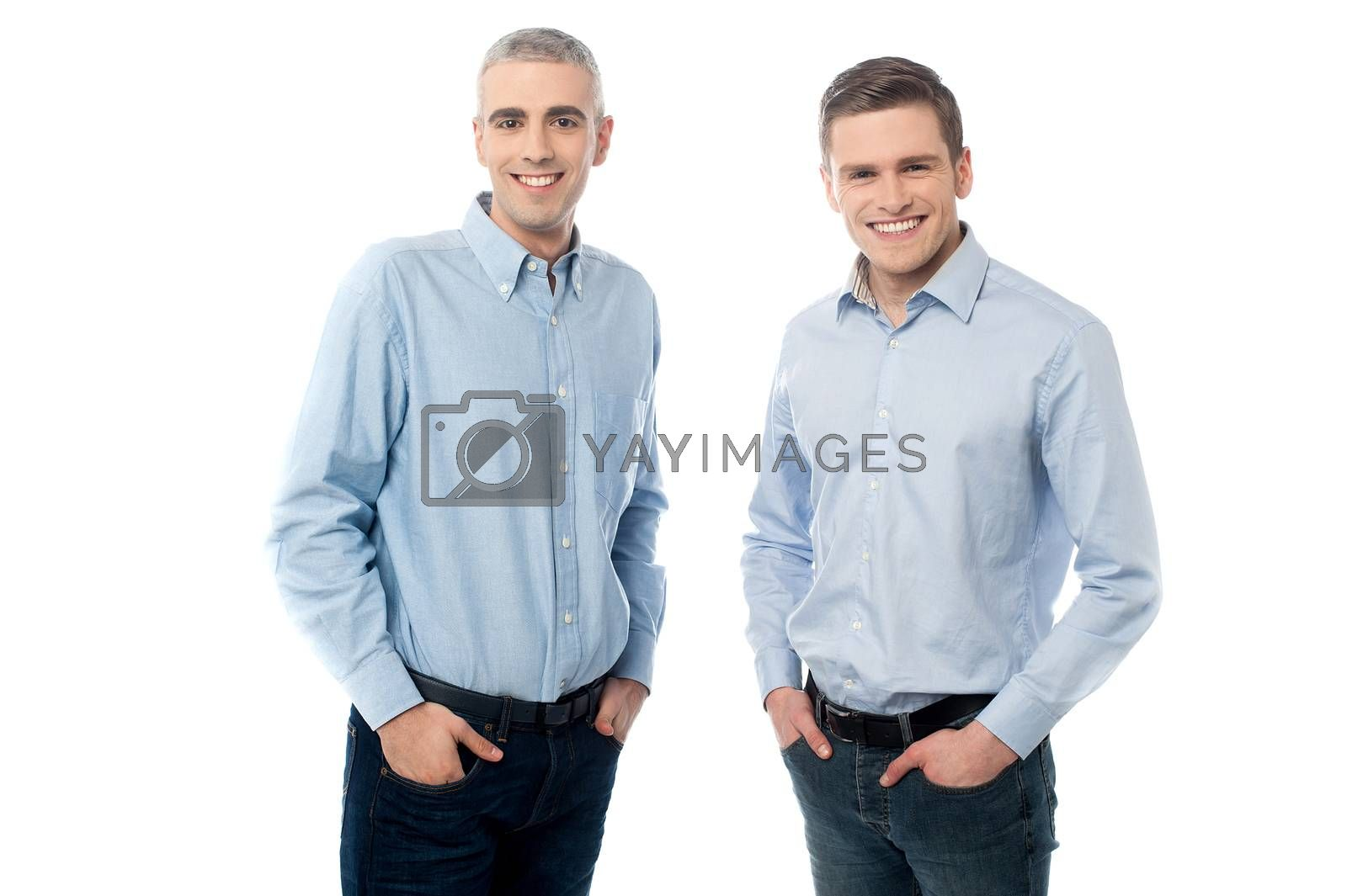 Casual  pose of happy young friends over white