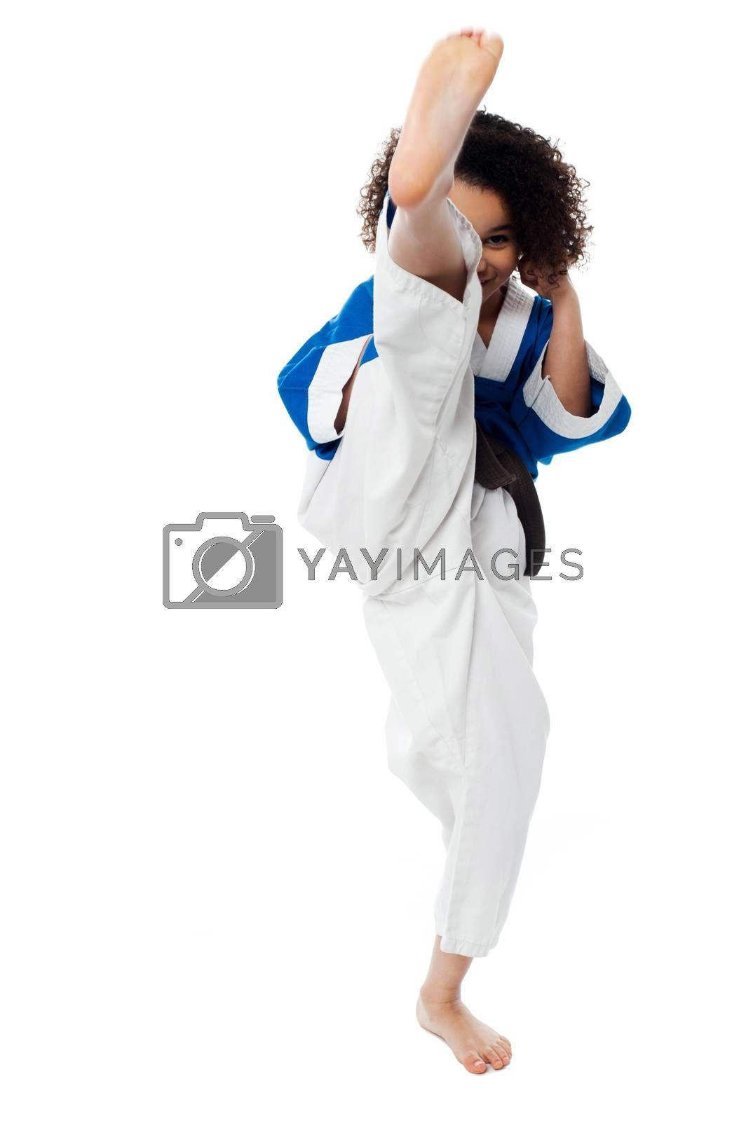 Image of a little girl practice karate over white