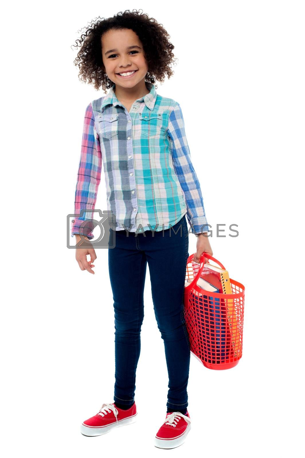 Image of a happy girl with basket over white