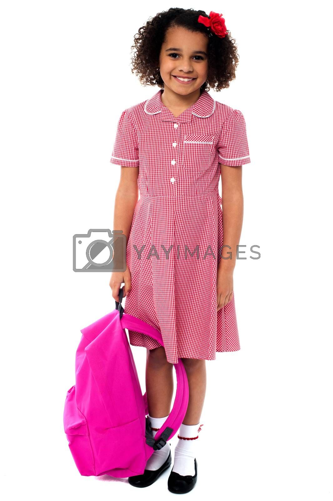 Smiling school girl posing with backpack over white