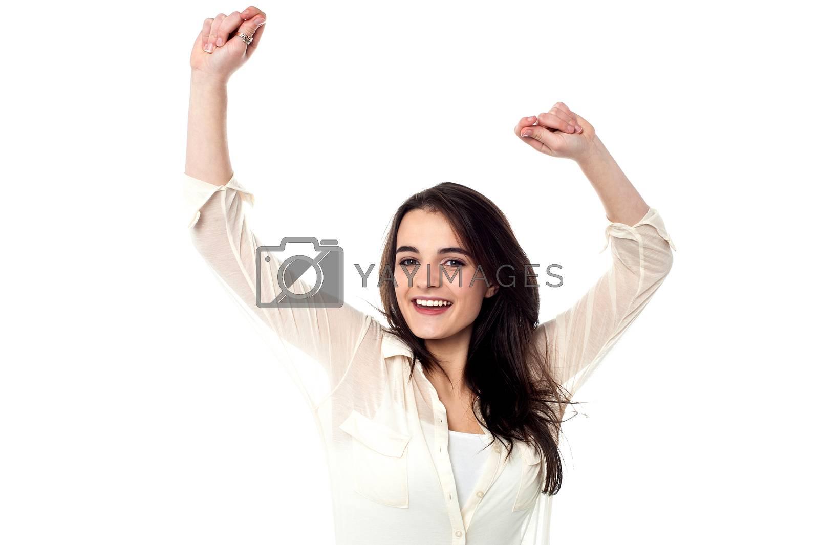 Happy teen girl dancing, isolated over white