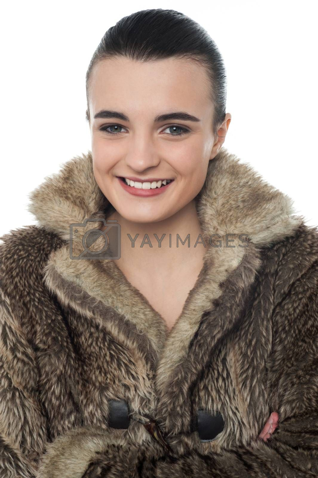 Image of a stylish young girl in fur jacket