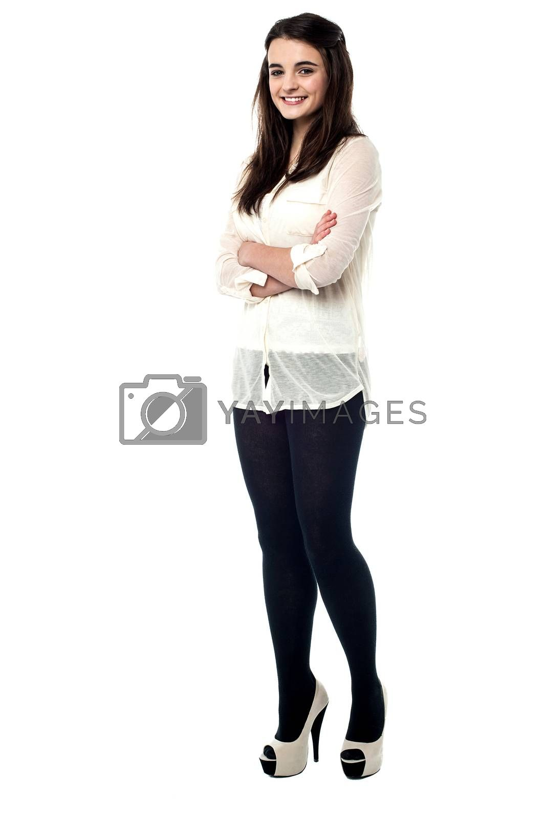 Full length of stylish teen girl with folded arms
