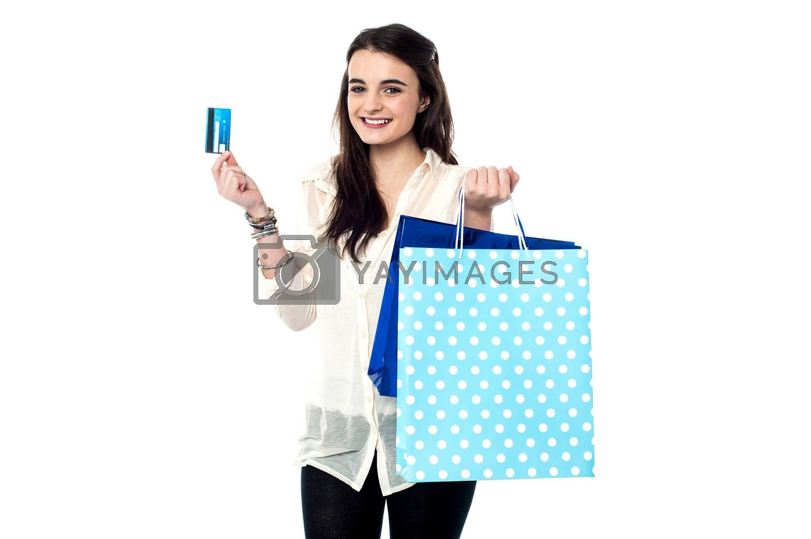Teen girl showing credit card after her shopping